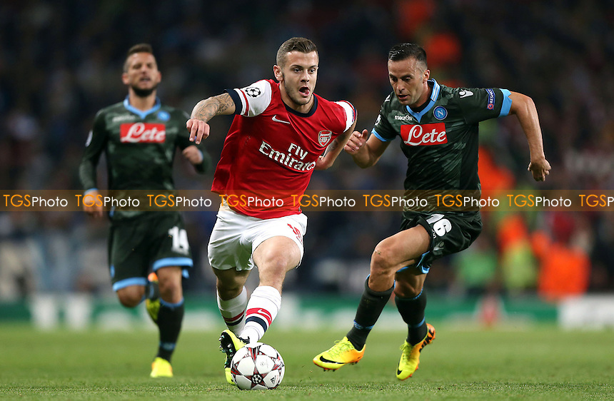 Jack Wilshere of Arsenal goes past Giandomenico Mesto of Napoli - Arsenal vs Napoli, Champions League Group F game at the Emirates Stadium, Arsenal - 01/10/13 - MANDATORY CREDIT: Rob Newell/TGSPHOTO - Self billing applies where appropriate - 0845 094 6026 - contact@tgsphoto.co.uk - NO UNPAID USE