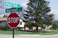 A suburban cross street in Ohio shows where township meets city and street sign colors change.