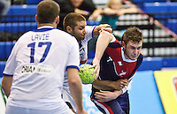 02 NOV 2011 - LONDON, GBR - Britain's Chris Mohr (right, in blue and red) is tackled by Israel's Chen Pomeranz (centre) during the Men's 2013 World Handball Championship qualification match at the National Sports Centre at Crystal Palace .(PHOTO (C) NIGEL FARROW)