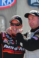 May 15, 2011; Commerce, GA, USA: NHRA top fuel dragster driver Clay Millican (left) with Bob Vandergriff Jr during the Southern Nationals at Atlanta Dragway. Mandatory Credit: Mark J. Rebilas-