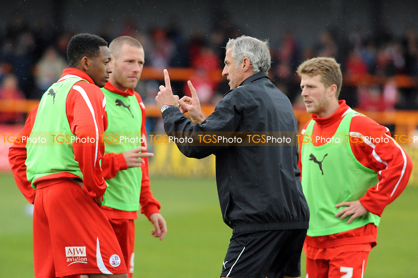 Crawley Town caretaker manager Craig Brewster gives a pre-match pep-talk to Sergio Torres of Crawley Town, Gary Alexander of Crawley Town and Billy Clarke of Crawley Town - Barnet vs Crawley Town - nPower League Two Football at Underhill Stadium - 09/04/12 - MANDATORY CREDIT: Anne-Marie Sanderson/TGSPHOTO - Self billing applies where appropriate - 0845 094 6026 - contact@tgsphoto.co.uk - NO UNPAID USE.