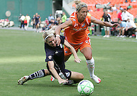 Emily Janss #11 of Washington Freedom is knocked down by Kacey White #20 of Sky Blue FC during a WPS match at RFK Stadium on May 23, 2009 in Washington D.C. Freedom won the match 2-1