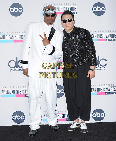 MC HAMMER (Stanley Kirk Burrell) & Psy (Park Jae sang).40th Anniversary American Music Awards - Press Room held at Nokia Theatre L.A. Live, Los Angeles, California, USA..November 18th, 2012.AMA AMAs full length black white suit bandana sunglasses shades hand v peace sign harem trousers sequins sequined jacket.CAP/DVS.©DVS/Capital Pictures.