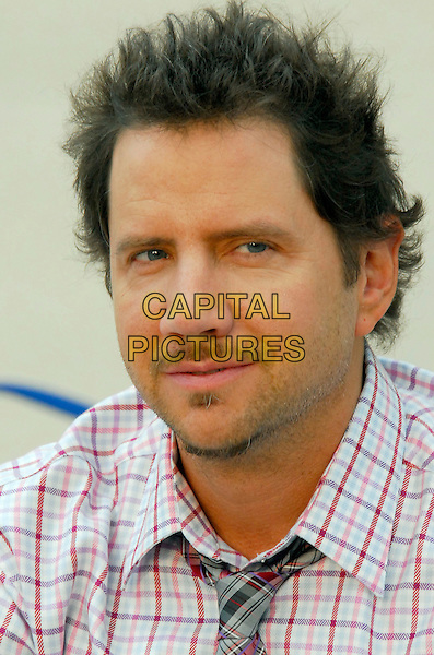 "JAIME KENNEDY.Poses at a photocall for ""The Ghost Whisperer"" during the 2009 Monte Carlo Television Festival at Grimaldi Forum, Monte Carlo, Monaco..June 9th, 2009.headshot portrait jamie red white check shirt tie plaid tartan stubble facial hair .CAP/RD.©Richard Dean/Capital Pictures."