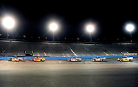 Nov. 13, 2009; Avondale, AZ, USA; NASCAR Camping World Truck Series drivers race through turn four during the Lucas Oil 150 at Phoenix International Raceway. Mandatory Credit: Mark J. Rebilas-