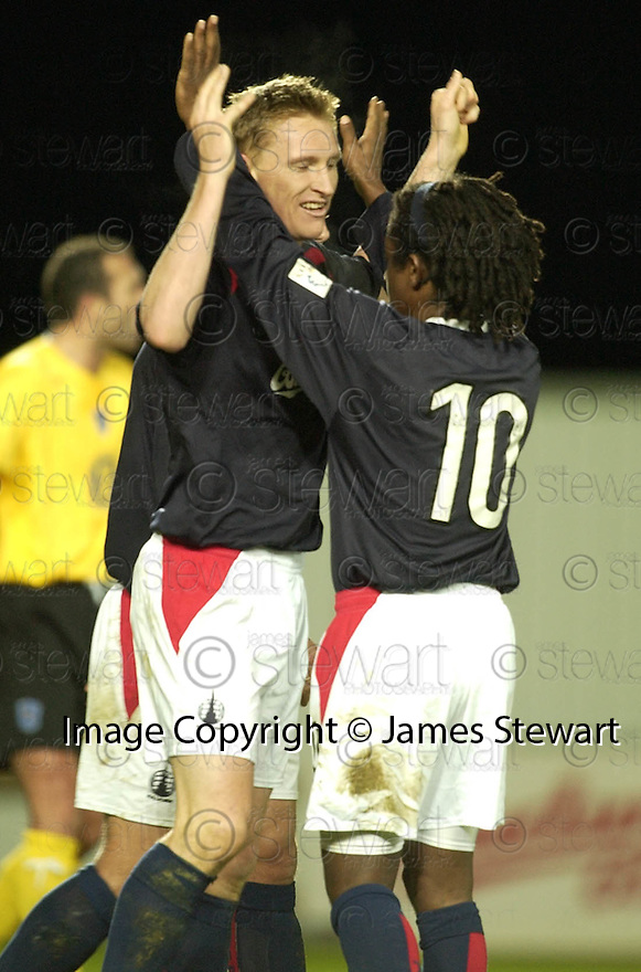 18/12/2004  Copyright Pic : James Stewart.File Name : jspa11_falkirk_v_qots.DANIEL MCBREEN CELEBRATES SCORING HIS HAT TRICK AND FALKIRK'S FOURT WITH RUSSELL LATAPY......Payments to :.James Stewart Photo Agency 19 Carronlea Drive, Falkirk. FK2 8DN      Vat Reg No. 607 6932 25.Office     : +44 (0)1324 570906     .Mobile   : +44 (0)7721 416997.Fax         : +44 (0)1324 570906.E-mail  :  jim@jspa.co.uk.If you require further information then contact Jim Stewart on any of the numbers above.........