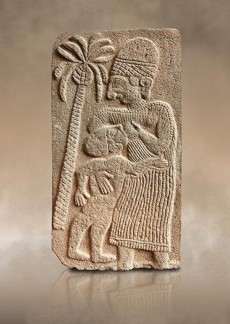 Pictures & images of the North Gate Hittite sculpture stele depicting a women breast feeding a child. 8the century BC.  Karatepe Aslantas Open-Air Museum (Karatepe-Aslantaş Açık Hava Müzesi), Osmaniye Province, Turkey. Against art background