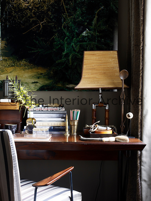 Anne Hardy's photograph 'Lumber' hangs above the work table in the study