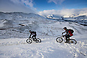29/12/14<br /> <br /> After the lowest overnight temperatures recorded this winter, Nick Clayton and Mark Brind (leading) cycle along a snow covered bridleway on the edge of Mam Tor in the Derbyshire Peak District near Castleton.<br /> <br /> <br /> All Rights Reserved - F Stop Press. www.fstoppress.com. Tel: +44 (0)1335 300098