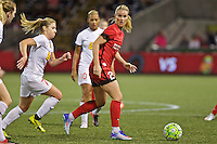 Portland, Oregon - Sunday September 11, 2016: Portland Thorns FC midfielder Amandine Henry (28) and Western New York Flash midfielder McCall Zerboni (7) during a regular season National Women's Soccer League (NWSL) match at Providence Park.