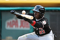 Trayvon Robinson (21) of the Albuquerque Isotopes squares to bunt against the Salt Lake Bees at Smith's Ballpark on April 21, 2014 in Salt Lake City, Utah.  (Stephen Smith/Four Seam Images)