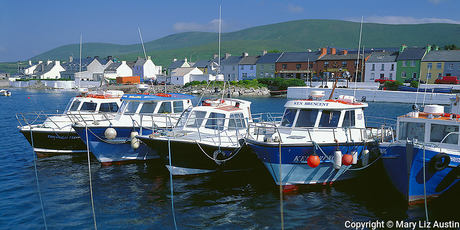 County Kerry, Ireland         <br /> Fishing boats and lines on the dock in Portmagee Channel with the town of Portmagee in the background