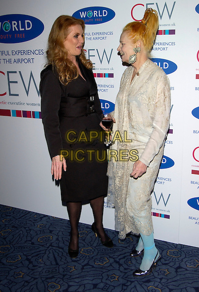 SARAH FERGUSON, DUCHESS OF YORK & VIVIENNE WESTWOOD.The Cosmetic Executive Women (UK) Achiever Awards 2004, The Mirror Room, Claridge's, .London, October 27th 2004..full length royal royalty black suit jacket skirt glass of red wine drink.Ref: PL.www.capitalpictures.com.sales@capitalpictures.com.©Capital Pictures.