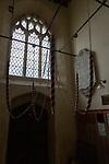 Bell tower ropes inside village parish church of All Saints, Yatesbury, Wiltshire, England, UK
