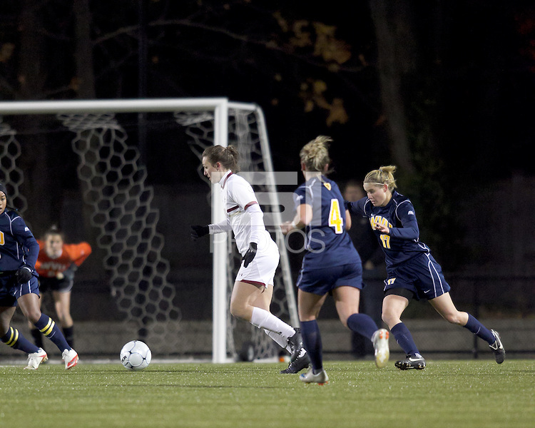 """Boston College forward Brooke Knowlton (16) dribbles on offense as West Virginia forward Erica Henderson (17) closes. Boston College defeated West Virginia, 4-0, in NCAA tournament """"Sweet 16"""" match at Newton Soccer Field, Newton, MA."""