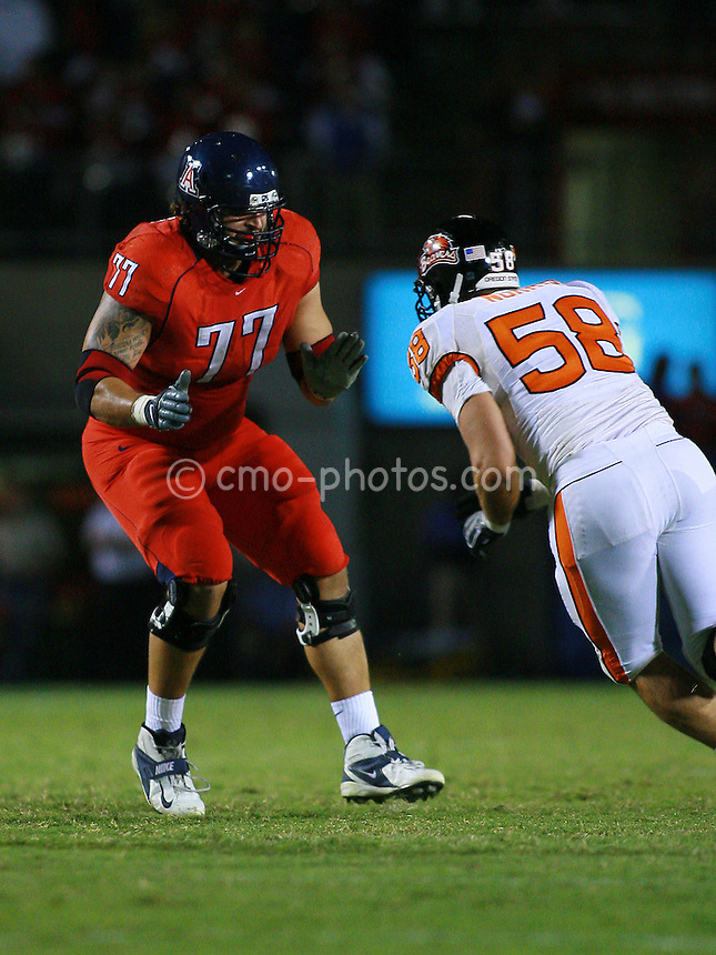 Nov 22, 2008; Tucson, AZ, USA; Arizona Wildcats tackle Eben Britton (77) blocks Oregon State Beavers linebacker Slade Norris (58) in the third quarter of a game at Arizona Stadium.  Oregon State won the game 19-17.