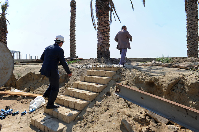 (At right) Ibrahim Ibrahimov, an Azerbaijani oligarch and billionaire, is seen on site of the of the Khazar Islands project near Sahil, Azerbaijan on July 18, 2012.  The brainchild of Ibrahimov, the artificial Khazar Islands project just southwest of the Azerbaijani capital Baku is being built at a projected cost of $100 billion with an anticipated 800,000 housing units.