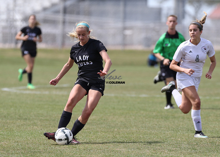 Vandegrift sophomore Grace Andres (3) passes the ball during the girls soccer regional semifinal playoff game between Vandegrift High School and Pioneer High School on April 8, 2016. Vandegrift defeated Pioneer 5-0 to advance to the regional final.