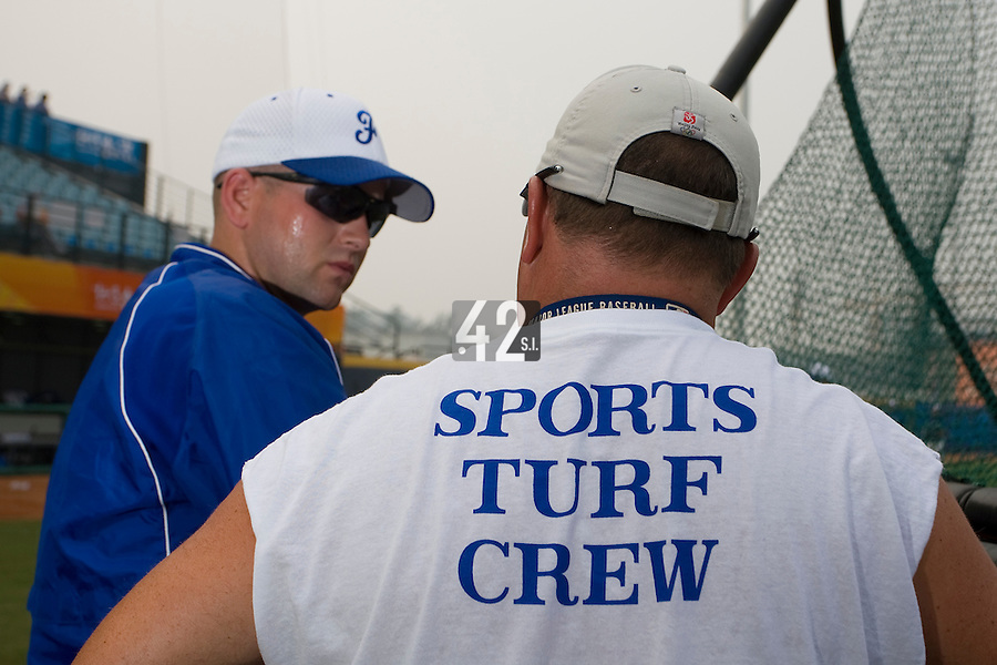 20 August 2007: Coach Joshua Ridgway (left) talks to Sports Turf Superintendent Budgie Clark (right) prior to the Czech Republic 6-1 victory over France in the Good Luck Beijing International baseball tournament (olympic test event) at the Wukesong Baseball Field in Beijing, China.