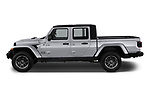 Car driver side profile view of a 2020 Jeep Gladiator Overland 4 Door Pick Up