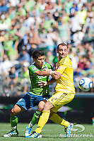 Seattle Sounders FC forward Fredy Montero (17) tries to push past Columbus Crew defender Rich Balchan (2) at CenturyLink Field in Seattle, Washington. The Sounders defeated Columbus Crew, 6-2.