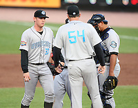 Syracuse Chiefs Starting Pitcher Stephen Strasburg (37) listens to Pitching Coach Greg Booker (54) with Catcher Carlos Maldonado (right) and First baseman Josh Whitesell (hidden) during a game vs. the Rochester Red Wings Wednesday, May 19, 2010 at Frontier Field in Rochester, New York.   Syracuse defeated Rochester by the score of 5-1 as Strasburg earned his third win at the Triple-A level with no losses.  Photo By Mike Janes/Four Seam Images