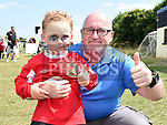 Luke and William Bracken pictured at the launch of Laytown United's sticker album at Seafields. Photo:Colin Bell/pressphotos.ie