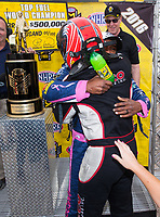 Oct 30, 2016; Las Vegas, NV, USA; NHRA top fuel driver Antron Brown is congratulated by Steve Torrence as he celebrates after clinching championship during the Toyota Nationals at The Strip at Las Vegas Motor Speedway. Mandatory Credit: Mark J. Rebilas-USA TODAY Sports