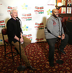 """Clay Aiken and Ruben Studdard attend the Broadway Preview Photo Call for """"Ruben & Clay's First Annual Christmas Carol Family Fun Pageant"""" at Sardi's on November 15, 2018 in New York City."""