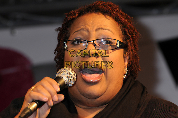 Jocelyn Brown.BBC Children In Need's Pudsey Street -photocall, New Piazza, Covent Garden, London, England..3rd November 2012.on stage in concert live gig performance performing music singing headshot portrait glasses microphone    .CAP/PP/BK.©Bob Kent/PP/Capital Pictures
