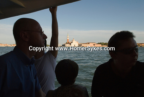 Venice Italy 2009. The church of San Giorgio Maggiore, tourist on a vaporetto waterbus.