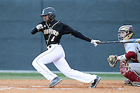 Left fielder Demetrius Jennings (1) of the Wofford College Terriers bats in a game against the Boston College Eagles on Friday, February 13, 2015, at Russell C. King Field in Spartanburg, South Carolina. The BC catcher is Nick Sciortino. Wofford won, 8-4. (Tom Priddy/Four Seam Images)