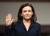 """Sheryl Sandberg, Chief Operating Officer, Facebook, is sworn-in to give testimony before a United States Senate Select Committee on Intelligence hearing """"to examine foreign influence operations' use of social media platforms"""" on Capitol Hill in Washington, DC on Wednesday, September 5, 2018.<br /> Credit: Ron Sachs / CNP<br /> (RESTRICTION: NO New York or New Jersey Newspapers or newspapers within a 75 mile radius of New York City)"""