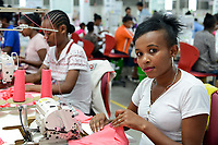 ETHIOPIA , Southern Nations, Hawassa or Awasa, Hawassa Industrial Park, chinese-built for the ethiopian government to attract foreign investors with low rent and tax free to establish a textile industry and create thousands of new jobs, textile company Hela Indochine Apparel PLC a joint venture of sri lankan and chinese companies / AETHIOPIEN, Hawassa, Industriepark, gebaut durch chinesische Firmen fuer die ethiopische Regierung um die Hallen fuer Textilbetriebe von Investoren zu vermieten, Textilfabrik Hela Indochine Apparel PLC, Textilarbeiterin Zenach Bogala (18)