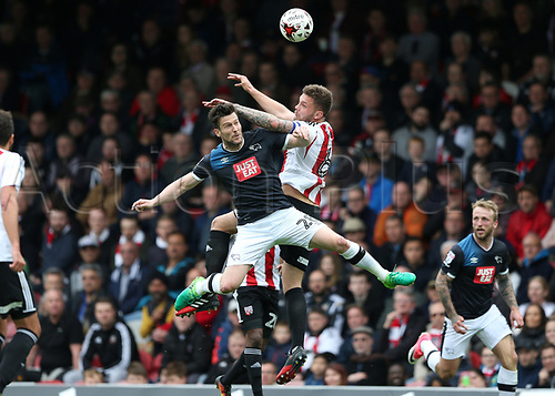 April 14th 2017,  Brent, London, England; Skybet Championship football, Brentford versus Derby County; Harlee Dean of Brentford beats David Nugent of Derby County to head the ball out