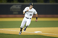 Cole McNamee (40) of the Wake Forest Demon Deacons rounds third base during the game against the North Carolina State Wolfpack at David F. Couch Ballpark on April 18, 2019 in  Winston-Salem, North Carolina. The Demon Deacons defeated the Wolfpack 7-3. (Brian Westerholt/Four Seam Images)