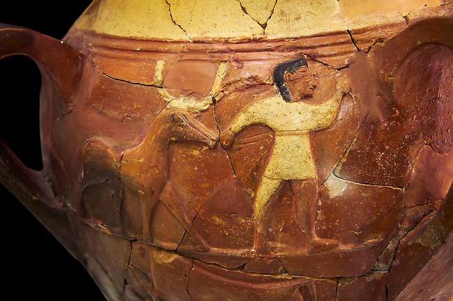 Hüseyindede vases, Old Hittite Polychrome Relief vessel, third freeze down depicting a man leading a bull, 16th century BC. Huseyindede . Çorum Archaeological Museum, Corum, Turkey. Against a black bacground.