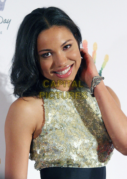 JURNEE SMOLLETT.46664 and The Nelson Mandela Foundation Launch 'Mandela Day' Awareness Event at the Beverly Hills Hotel, Beverly Hills, CA, USA..May 14th, 2009.half length silver gold sequins sequined dress black belt hand bracelet .CAP/ADM/TC.©T. Conrad/AdMedia/Capital Pictures.