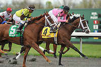 In Lingerie (4) with John Velazquez riding, trained by Graham Motion, leads the field at the start of the Grade 3 Bourbonette Oaks at Turfway Park in Florence, Kentucky on Saturday March 24, 2012.