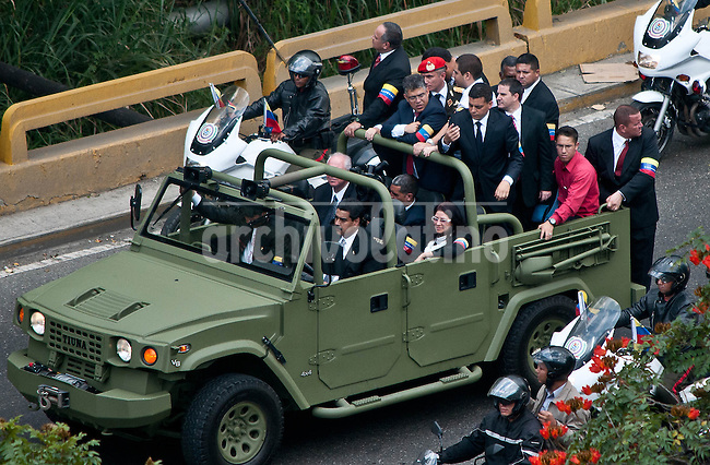 "Venezuela: Caracas,15/03/13 .he Acting President Nicolas Maduro driving a military vehicle, accompanied by Bolivian President Evo Morales (to him), the Attorney General Cilia Flores (2 row right), Energy Minister Rafael Ramirez (2 row left), President of the National Assembly Diosdado Cabello (3 row left), Foreign Minister Elias Jaua (3 row center) during the funeral procession with the remains of Venezuelan President Hugo Chavez, toward the headquarters of the Mountain, in the neighborhood  ""23 de Enero"", the same place where he installed his command post in the coup of February 4, 1992, against President Carlos Andres Perez, and delivered his famous ¨for now"", the acceptance speech of defeat that made it popular among Venezuelans..Carlos Hernandez/Archivolatino"