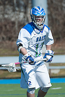 Ross Burr,'16, gets into position as the Seahawks battle Endicott in Men's Lacrosse game action at Gaudet Field in Middletown.