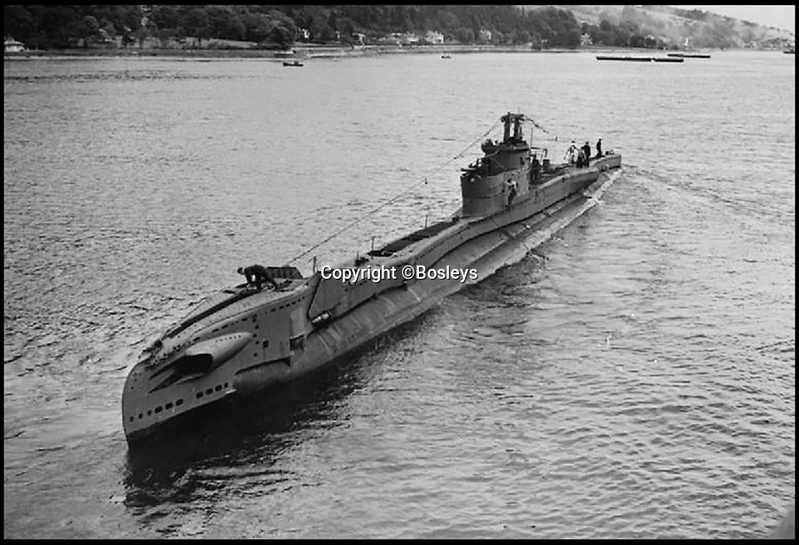 BNPS.co.uk (01202 558833)Pic: Bosleys/BNPS<br /> <br /> HMS Thule.<br /> <br /> Up Periscope - WW2 British Sub's victorious Jolly Roger resurface's.<br /> <br /> Secret Service - The incredibly rare Jolly Roger flag flown by a British submarine during World War Two with symbols denoting enemy vessels sunk has surfaced. <br /> <br /> The black and white flag with a skull and crossbones in the middle documents the service of HMS Thule which served in the Far East.<br /> <br /> At the end of the conflict it was gifted by the captain to Able Seaman William Fern who, as the youngest crew member, had the job of maintaining and updating the Jolly Roger.