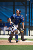 GCL Blue Jays catcher Hagen Danner (33) looks for a popup in front of umpire Zachary Robbins during a game against the GCL Pirates on July 20, 2017 at Bobby Mattick Training Center at Englebert Complex in Dunedin, Florida.  GCL Pirates defeated the GCL Blue Jays 11-6 in eleven innings.  (Mike Janes/Four Seam Images)