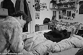Kids relaxing in bed, Summerhill school, Leiston, Suffolk, UK. 1968.