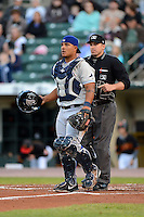 Durham Bulls catcher Juan Apodaca #13 and umpire Jeff Gosney watch the play develop during a game against the Rochester Red Wings on May 17, 2013 at Frontier Field in Rochester, New York.  Rochester defeated Durham 11-6.  (Mike Janes/Four Seam Images)