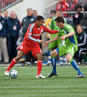 Amado Guevara (left) of Toronto FC and Sebastien LeToux (9) of the Seattle Sounders FC in MLS action at BMO Field on April 4, 2009. Seattle won 2-0.