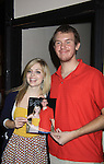 """General Hospital's Jen Lilley """"ex-Maxie"""" poses with fan Eric - both are wearing the same outfits they wore at another event at Uncle Vinnie's Comedy Club on September 9, 2012 in Pt. Pleasant, New Jersey to see their fans for autographs, meet/greet and photos.  (Photo by Sue Coflin/Max Photos)"""