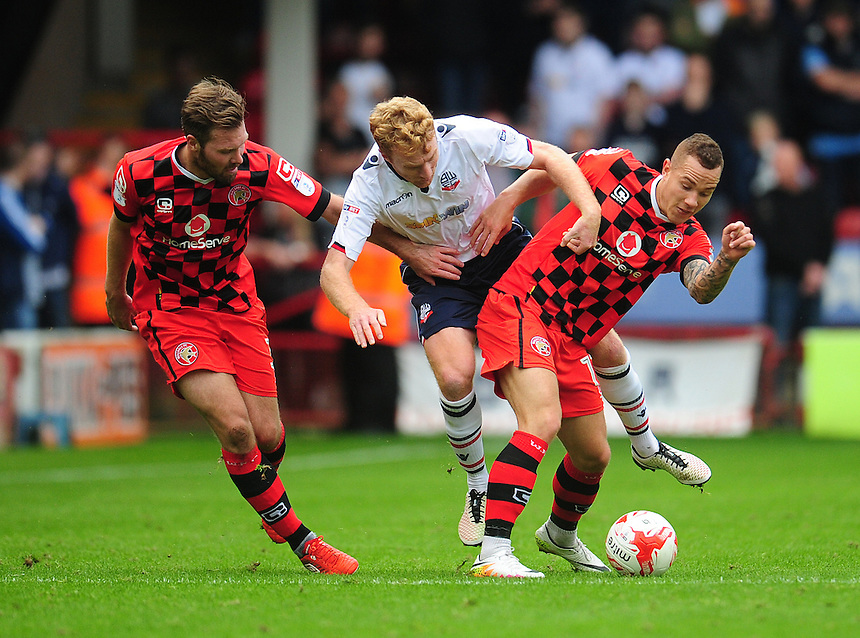 Bolton Wanderers' Chris Taylor vies for possession with Walsall&rsquo;s Kieron Morris (right) and Scott Laird<br /> <br /> Photographer Kevin Barnes/CameraSport<br /> <br /> The EFL Sky Bet League One - Walsall v Bolton Wanderers - Saturday 17th September 2016 - Banks's Stadium - Walsall<br /> <br /> World Copyright &copy; 2016 CameraSport. All rights reserved. 43 Linden Ave. Countesthorpe. Leicester. England. LE8 5PG - Tel: +44 (0) 116 277 4147 - admin@camerasport.com - www.camerasport.com