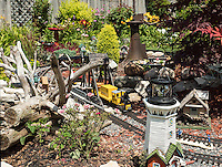 Mary and Kent Bettridge<br /> 609 Cherry Drive<br /> markent23@hotmail.com<br /> <br /> Our garden was started 15 years ago with nothing in the yard. I had brought 350 perennials from my other house and got started here. The garden consists of a great variety of perennials, tropicals  and annuals. Lilies dominate the garden in July. It is always buzzing with bees, butterflies, bunnies, chipmunks and birds. In 2009 Kent added the garden railway in the centre of the garden. This weekend he has put in an authentic 1933 Railway Switch he found in Godrich. Also new this year are a few fairy gardens to add interest. This is a shared hobby for us and we are very passionate about it. I can think of nowhere I would rather be then in our back yard.