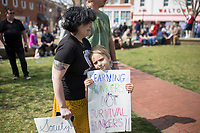 NWA Democrat-Gazette/CHARLIE KAIJO Ali Johnson of Pea Ridge (left) demonstrates with her son Becket Johnson, 7, during the &quot;March For Our Lives&quot; rally, Saturday, March 24, 2018 at the Bentonville Square in Bentonville. <br /> <br /> &quot;I&rsquo;m a teacher. I&rsquo;m married to a teacher and we want to stand with out students,&quot; said Johnson. &quot;I didn&rsquo;t go into teaching for the love of the subject but for the love of the students. I want them to feel safe and valued. I want them to know that we're doing everything we can to make the classroom environment a safe place to learn and we&rsquo;re not ignoring them.&quot;<br /> <br /> &ldquo;March For Our Lives&rdquo; is a march against gun violence. &quot;[We're] just a group of kids who got together one day and wanted to make a change,&quot; said Taylor Gibson, 16, a student at Bentonville West High School. She is one of nine students from area high schools including Bentonville West, Bentonville High, Gravette and Haas Hall who organized the rally. The rally is in solidarity with more than 800 protests around the world according to &quot;March For Our Lives&quot; organizers